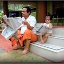 A father and his little son read in paper | 2 dogs are very happy | Scoop.it