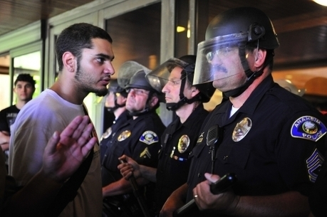 Riot police, protesters clash in AnaheimPictures - CBS News | Community Village Daily | Scoop.it