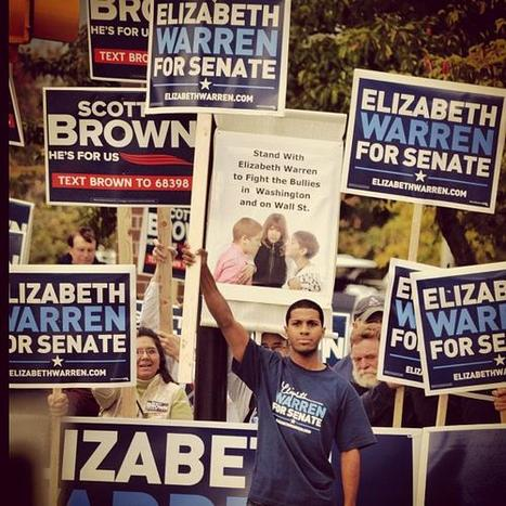 photo: A man stands up for Elizabeth Warren outside the Tsongas center in Lowell | Massachusetts Senate Race 2012 | Scoop.it