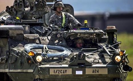 A U.S. Army Stryker infantry carrier vehicle convoys across the flightline during Steadfast Javelin II exercise | MilPolSec | Scoop.it