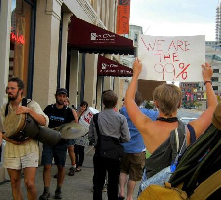"""Occupy Grand Rapids"" group protests at Biden fundraiser 