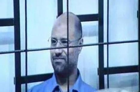 "Saif Smiling ... ""From inside the court was deliberately cut the sound when he started the captive Saif al-Islam Gaddafi to speak "" 