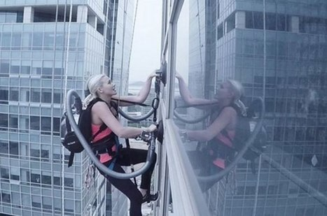 Watch: This Woman Climb A 460-Foot Building Using Vacuum Cleaners | WTF Posts | Scoop.it