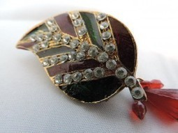 Clear diamanté earring and colourful broach | Interesting box | Scoop.it