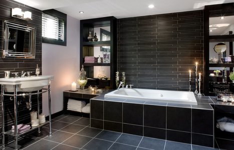 A luxurious, spacious bathroom rises from the depths of a basement junkroom | Toronto Star | Aqualisa showers | Scoop.it