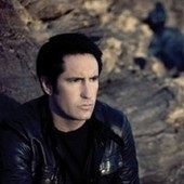 "The Associated Press is really into Nine Inch Nails' ""cover of Johnny Cash's 'Hurt'"" 