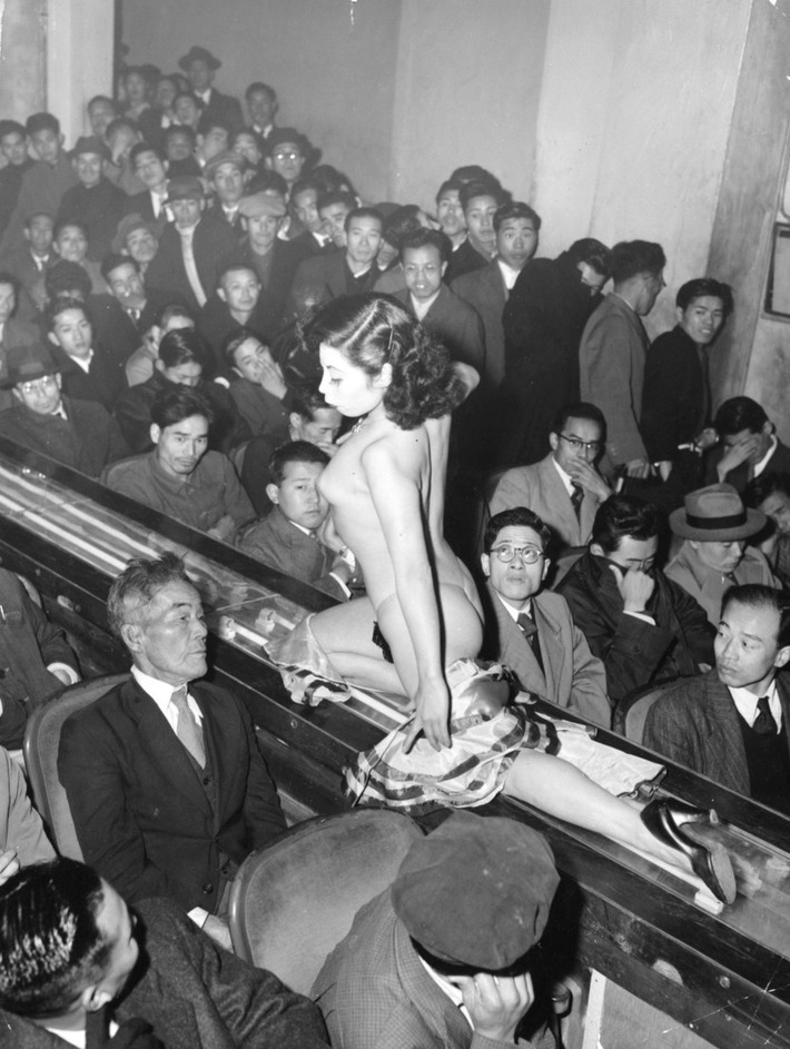 A stripper at a Tokyo striptease show on a lighted walkway 1957 | Sex History | Scoop.it