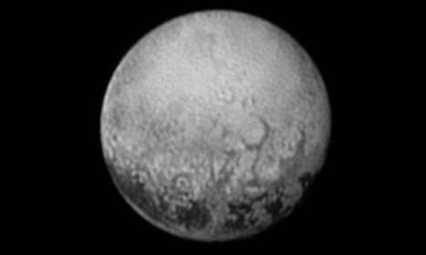 Scientists get their last look at Pluto's mysterious dark spots | Physics as we know it. | Scoop.it