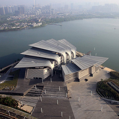 Eight Huge Wings Resembling a Cluster of Duck Feet Form the Roof of Wuxi Grand Theatre by PES-Architects   Extreme Architecture   News, E-learning, Architecture of the future at news.arcilook.com   Architecture news   Scoop.it