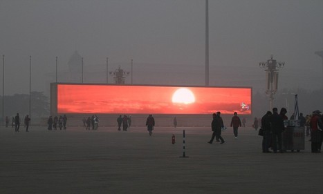 Beijing residents watch sunrise on giant commercial screens | World News | Scoop.it