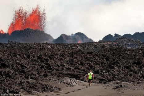 Photographer Tomas Freyr Kristjansson stands in face of lava | Geology | Scoop.it