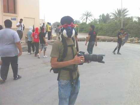 Ready for Citizen Journalism in Bahrain.......Gaskmask, goggles, full head covering, telephoto lens | Human Rights and the Will to be free | Scoop.it