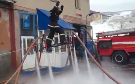 Russian firefighter rides wet 'magic carpet' | Strange days indeed... | Scoop.it