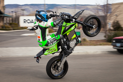 Shelina Moreda pulls a wheelie on the Brammo Engage electric supermoto prototype.   Brammo Electric Motorcycles   Scoop.it