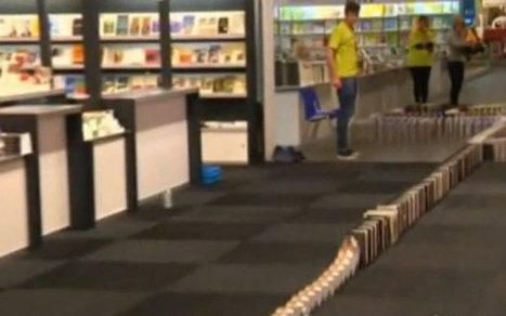 Record-breaking 5,000 book domino chain completed | Strange days indeed... | Scoop.it