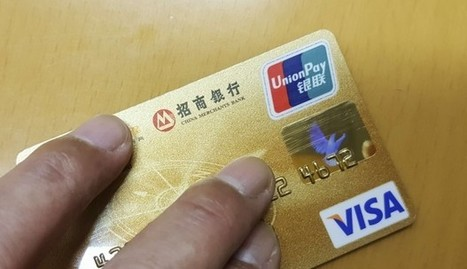 China orders banks to stop issuing dual-currency credit cards to stem capital flight | Payment | Scoop.it