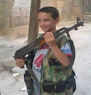 Alahednews:: Armed Groups in Syria Recruit Children: Phenomenon beyond Ethics, Laws | Armed Children in Syria and Lebanon | Scoop.it