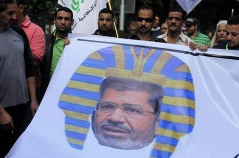 "Morsi's government pursues charges against newspaper for ""insulting"" comments 