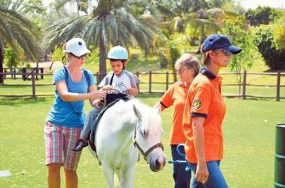 Equine therapy brings smiles to children | How to care for children with disabilities? | Scoop.it