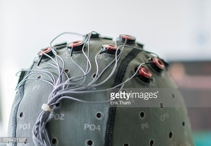Brain-Computer Interface hood worn by a test person at a lab of the... | La télépathique technologie (IND BCI) | Scoop.it