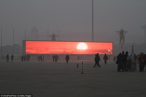 Beijing residents watch sunrise on giant commercial screens | Change | Scoop.it