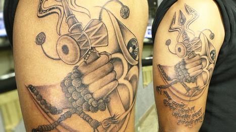Lord Shiva's Trishul, Damru, Rudraksha Mala in Hand, Maha Mrutyunjay Matra, Om and Third Eye in a Single Tattoo   Black Poison Tattoos   Scoop.it