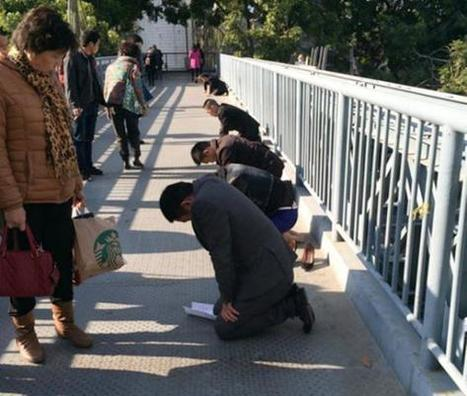 Sales execs who missed targets forced to kneel on public bridge and chant 'We are sorry' | International Business | Scoop.it