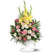 One arrangement with pink carnations and asters, white daisies, yellow gladioli and soft foliages is delivered in a white funeral basket with handle. | Flower Shop Toronto | Scoop.it