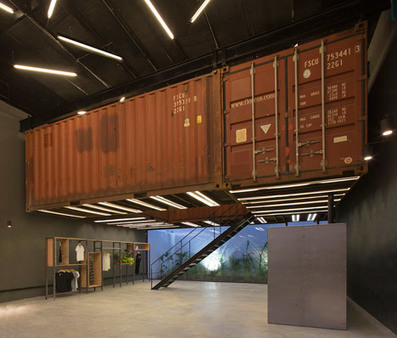 Shipping containers are suspended above shoppers inside Le Utthe boutique | Inspired By Design | Scoop.it