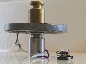"""Watch """"Tiny µTug Robot Pulls 2000x its Weight While Adhering to Glass Surface"""" Video at Engineering TV 