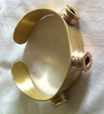 Fair trade Cambodia. Recycled Brass 3 bullet shell cuff, ethically handcrafted by disadvantaged home based workers.   Recycled Bomb Casings & Bullet Shell Jewellery   Scoop.it