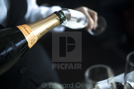 Bottle of champagne waiter pouring glass Veuve Cliquot Ponsardin nightclub disco at Picfair.com | Bodas | Scoop.it