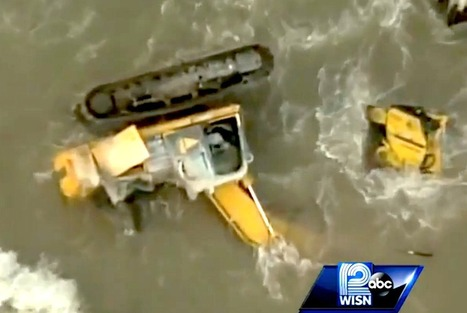 Brand new excavator driven off a 60-foot bluff and abandoned in icy Lake Michigan | Earthmoving & Compaction | Scoop.it