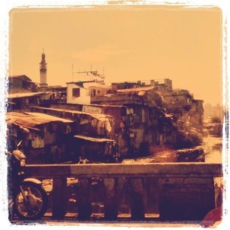 Looking Glass - View along Ayala Blvd. - informal settlers a.k.a. ... | Urbanism 3.0 | Scoop.it