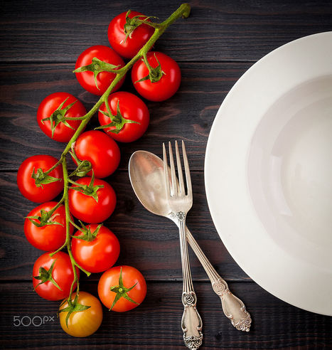 Plate on a wooden table with bunch tomatoes. by Irina Sokolovskaya | My Photo | Scoop.it