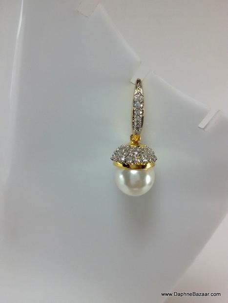AD Pearls Hangings Earrings | Ruby AD Pendant and Earrings | Scoop.it