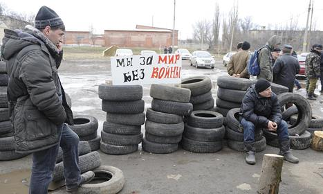 Protesters in Ukraine guard biggest weapons cache in eastern Europe | Secondary Education Social Studies | Scoop.it