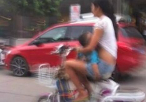 Woman Pulled Over For Breastfeeding On A Moped | Strange days indeed... | Scoop.it