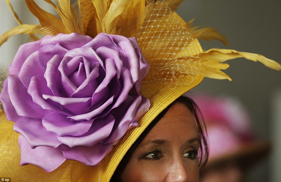 Hats off to them! Spectators at Kentucky Derby don't let the rain spoil annual display of fanciful racing fashions