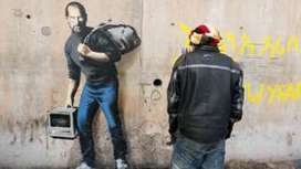 Banksy work in Calais 'Jungle' shows Steve Jobs as migrant - BBC News | Hip Hop for Social Change | Scoop.it