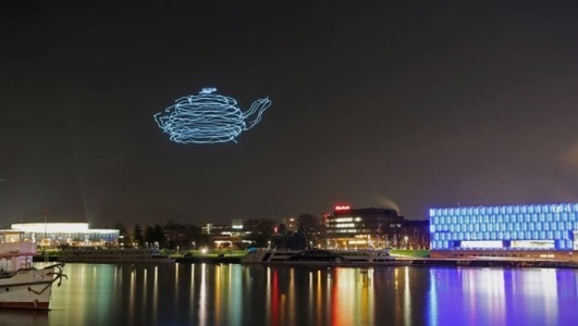 Drones programmed for light painting in the sky