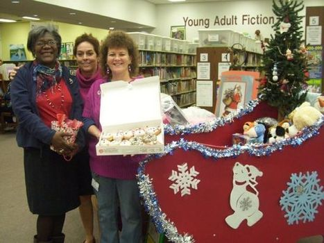Photo: Alma Straw (from left), P. Carson Culver and Brenda Bostick, staffers at Horn Lake Library, display a tasty gift they received from thoughtful library patrons. - Memphis, TN | The Commercial... | Tennessee Libraries | Scoop.it