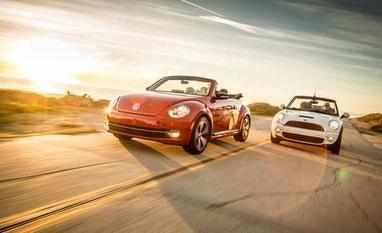 2013 Volkswagen Beetle Turbo Convertible vs. 2013 Mini Cooper S Convertible - Car and Driver | MINI Cooper | Scoop.it