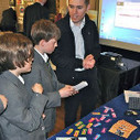 Alex Bradbury of Cambridge University demonstrates Raspberry Pi to school children at the Livery Schools Showcase | Raspberry Pi | Scoop.it