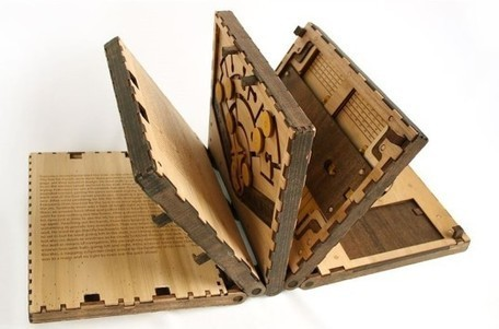 Readers must solve intricate puzzles to unlock the story in this gorgeous lasercut wooden book | relevant entertainment | Scoop.it
