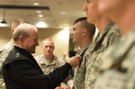 Army Gen. Martin E. Dempsey, chairman of the Joint Chiefs of Staff, left, presents a soldier with a Soldier's Medal on Fort Drum, N.Y | Military Shopping | Scoop.it