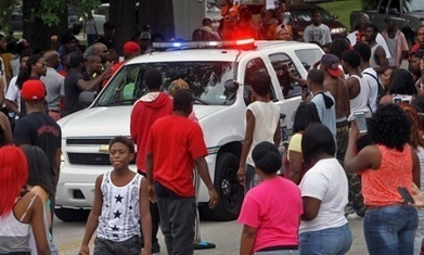 Ferguson: vigil for St Louis teenager killed by police descends into violence | news | Scoop.it