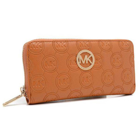 Michael Kors Monogram Embossed Zip Around Continental Wallet Brown   share and want   Scoop.it