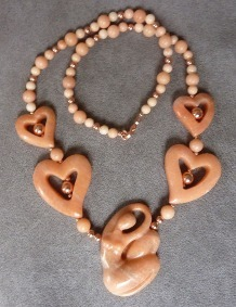Carved Peach Aventurine Lady and Hearts Necklace | Draped in Stone Jewelry | Scoop.it