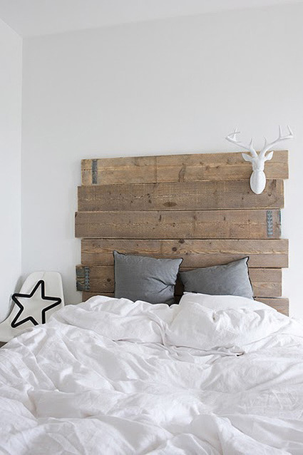 Reclaimed wood plank Headboard adds warmth to g...
